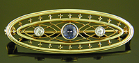 Brassler sapphire and diamond brooch. (J9324)