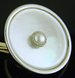 Carrington mother-of-pearl and pearl cufflinks. (J9429)