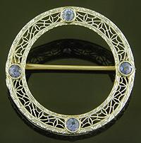 Art Deco sapphire circle brooch. (J9521)
