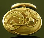 Larter Art Nouveau lucky cufflinks crafted in 14kt gold. (J9533)